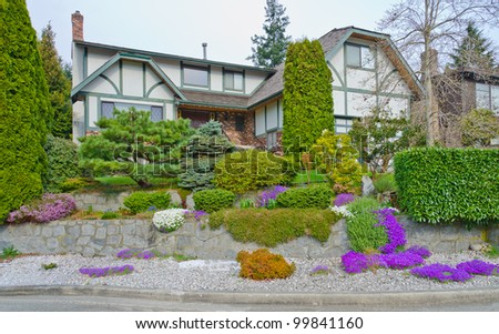 Landscape Design. Nicely Trimmed Bushes And Some Flowers At The ...