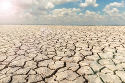 Landscape dried and cracked background. The soil dry land cracked ground surface with sky and cloudy.