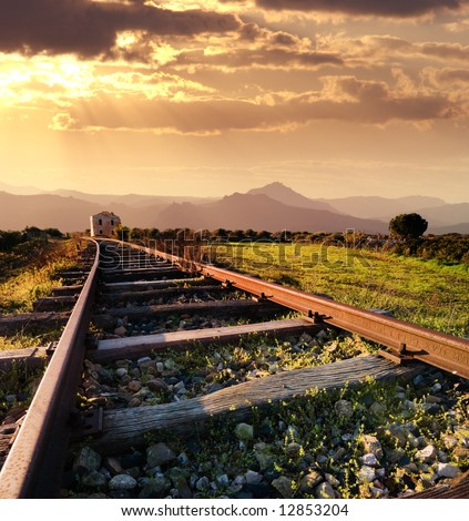 landscape for a old railway abandoned at the sunset