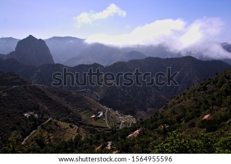 Landscape from a viewpoint where Roque Cano is seen near the city of Tamargada on the island of La Gomera, Canary Islands, Spain #1564955596