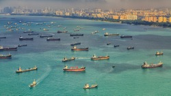 Landscape from bird view of Cargo ships entering one of the busiest ports in the world, Singapore.