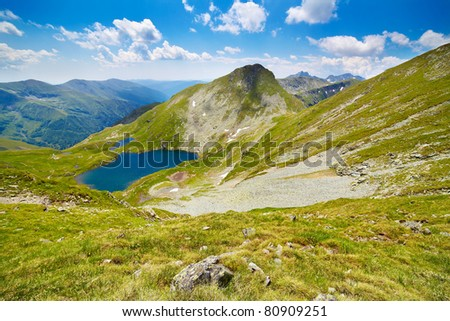 Landscape from Capra Lake in Romania and Fagaras mountains in the summer