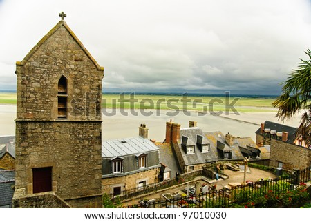 Landscape from Mont Saint Michel - stone church with Norman houses and bay of Mont Saint Michel