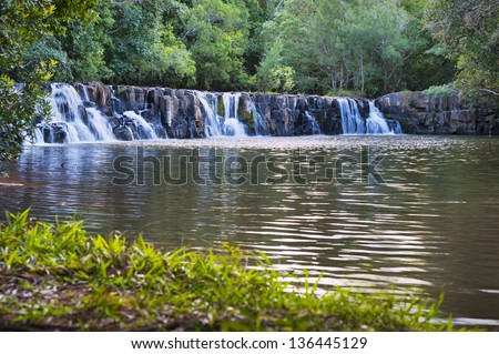 Landscape image of a small waterfall in a river. #136445129