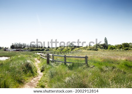 landscape image of fence of footpath in the countryside around the small village of Battlesbridge Stock photo ©