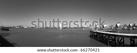 landscape image of thames barrier in london england uk