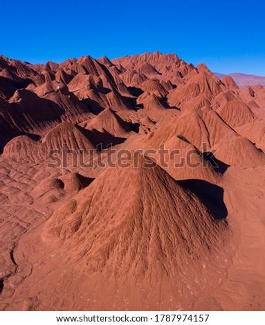 Landscape in Desierto del Diablo desert of Los Colorados in Tolar Grande area in The Puna grassland ecoregion of the Andes Mountains of Argentina in South America, America Stock fotó ©