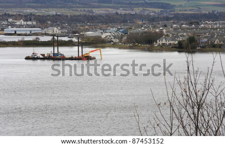 landscape in Scotland showing River Ness and ship near Inverness