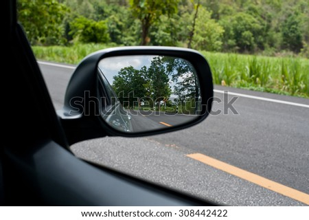 Landscape in the sideview mirror of a car, on road countryside, natural #308442422