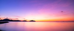 Landscape Long exposure of majestic clouds in the sky sunset or sunrise over sea with reflection in the tropical sea Beautiful cloudscape scenery Amazing light of nature Landscape..