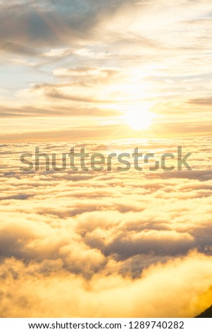 Landscape misty panorama. Fantastic dreamy sunrise on rocky mountains with view into misty valley below #1289740282