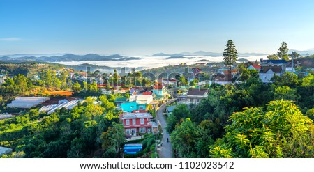 Photo of  Landscape morning in small village in the valley on the plateau, distant fog shrouded the great hidden house on the outskirts of Dalat, Vietnam