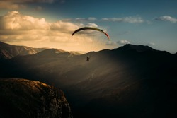 Landscape mountain and sky with paragliding