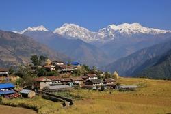 Landscape near Bhulbhule, Annapurna Conservation Area. Village and snow capped Manaslu range.