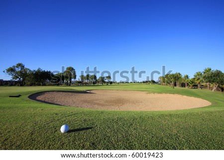 Landscape of a golf course on the coastline. - stock photo