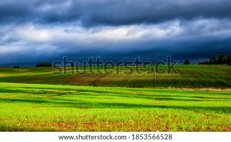 Landscape of a green hill during a cloudy day Stock photo ©