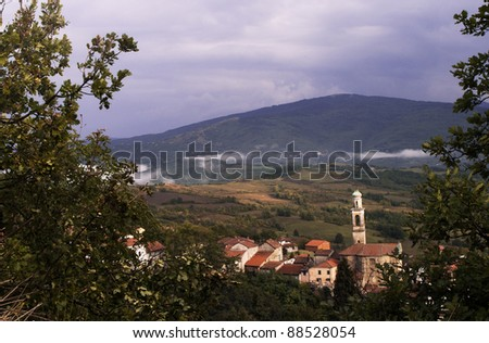 Landscape of a little village surrounded by clouds, Curone Valley (Val Curone), Piedmont, Italy