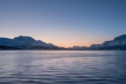 Landscape of a Norwegian fjord in winter. Polar night in Norway.
