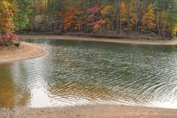 Landscape of a tree lined lake in Autumn with Fall colors