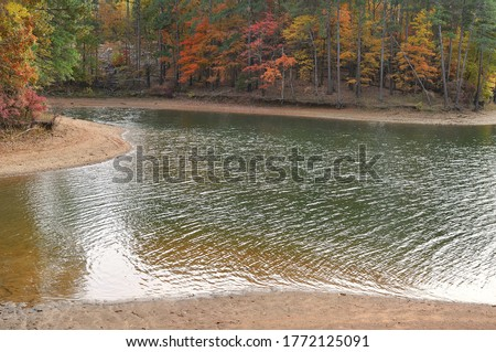 Photo of  Landscape of a tree lined lake in Autumn with Fall colors