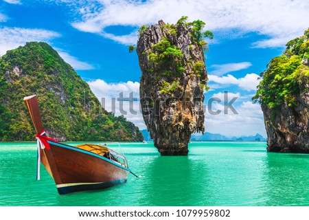 Landscape of amazing James Bond island with longtail boat waiting for traveler on tropical sea beach near Phuket, Travel nature adventure Thailand, Destination place Asia, Summer holiday vacation trip
