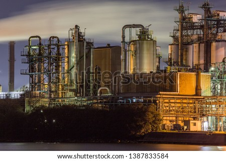 Landscape of an industrial park at night  #1387833584