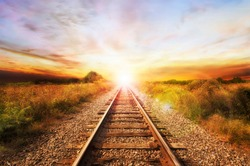 Landscape of an old abandoned railway at the sunrise. Sunny summer day.