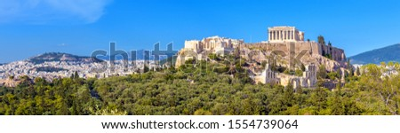 Landscape of Athens city with famous Acropolis, Greece. Old Acropolis is top landmark of Athens. Nice panorama of Athens with classical Greek ruins. Scenic view of majestic remains of ancient Athens.