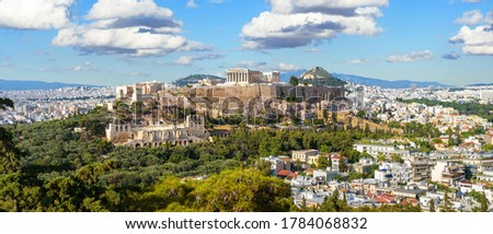 Landscape of Athens, Greece. Panoramic scenic view of Acropolis hill with Ancient Greek ruins in Athens city center. Acropolis is top landmark of Athens. Beautiful skyline of Athens in summer.