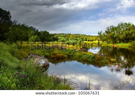 Landscape of beautiful lake and cloudy sky and sunlight in Springtime