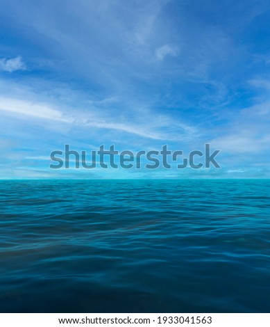 Landscape of blue sky with clouds and calm sea