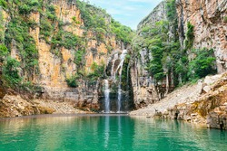 Landscape of Canyons of Furnas and the waterfall, Capitólio MG, Brazil. Green water of the lake between big sedimentary rocky walls. Mar de Minas, eco tourism destination of Minas Gerais state.