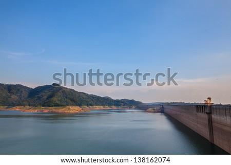 Landscape of concrete dam in sunny day