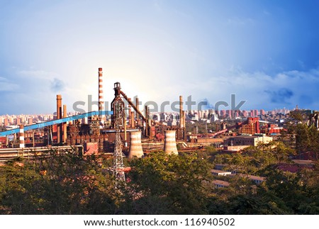 Landscape of construction power factories with big chimneys and modern buildings in background - stock photo