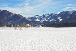 Landscape of countryside in snowy Switzerland in winter. Switzerland is a country in Europe. Switzerland has a high mountain range; from the Alps to Jura mountains.