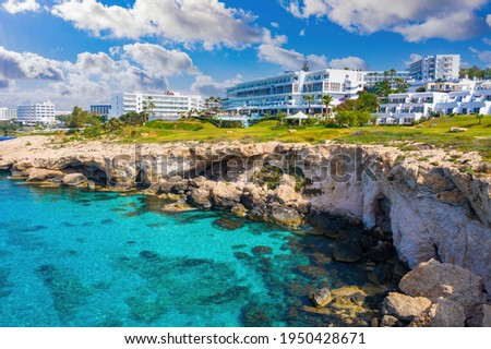 Landscape of Cyprus coast. Ayia Napa resort hotels. Hotel building near obrava. Cyprus panorama on a blue sky background. Tourism to Republic of Cyprus. Holidays at Ayia Napa Resort. Stock fotó ©