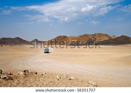 Landscape of desert with jeep