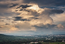Landscape of Dramatic Cloudy Sky Over The City at Chiang Mai of Thailand, Stormy Atmosphere Weather Situation With Dramatic Clouds Sky at Evening Sunset. Natural Cloud Sky background.
