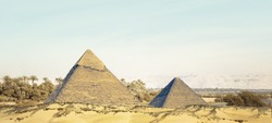 Landscape of Great pyramid of Khufu and Khafre in Egypt. Fantasy of egyptian landscape with ancient pyramid of Chephren and Cheops tombs. Wide panorama in green oasis of Nile valley with palms tree.