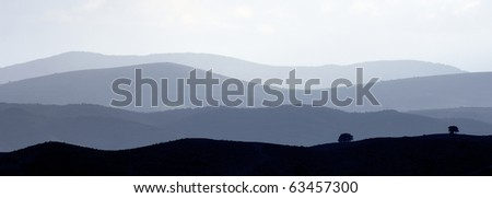 landscape of hills through the fog in spain