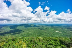 Landscape of Kingdom of Cambodia with cloudy sky. View from top of Pha Mo I Daeng viewpoint in Khao Phra Wihan National Park, Kantharalak,  Si Sa Ket, Thailand.