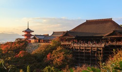 Landscape of Kiyomizu-dera ancient temple at sunset during autumn season, the most popular travel destination in Kyoto, Kansai, Japan