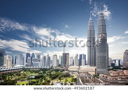 Landscape of  Kuala lumpur skyline, Malaysia under cloudy blue sky
