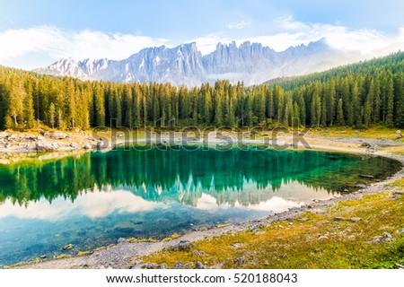 Landscape of Lake Carezza o Karersee and Dolomites in background, Nova Levante, Bolzano, Italy Foto stock ©