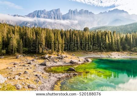 Landscape of Lake Carezza o Karersee with Dolomites in background, Nova Levante, Bolzano, Italy Foto stock ©