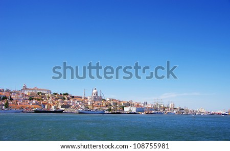 Landscape of Lisbon and sailboats - stock photo