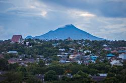 Landscape of Manado City with Manado Tua Mountain in the background, North Sulawesi, Indonesia