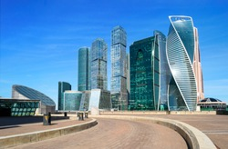 Landscape of modern Moscow city skyscrapers from observation point at summer or spring. Fantastic view of road, new buildings and high towers with blue sky. Urban photo of Russia capital downtown.