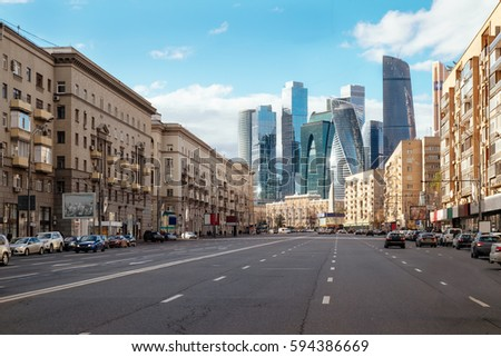 Landscape of Moscow architecture combining modern and old city, Russia. Outdoor modern Moscow city skyscrapers. Travel Russia and explore architecture landmarks of Moscow business center. Urban Moscow #594386669