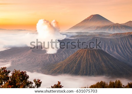 Landscape of Mount Bromo volcano, Batok and Semeru (Mt.) during sunrise from viewpoint on Mount Penanjakan located in Bromo Tengger Semeru National Park, East Java, Indonesia. #631075703